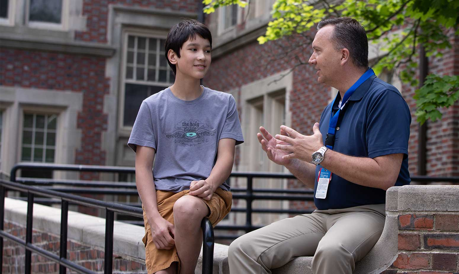 Teen boy speaks with McLean staff