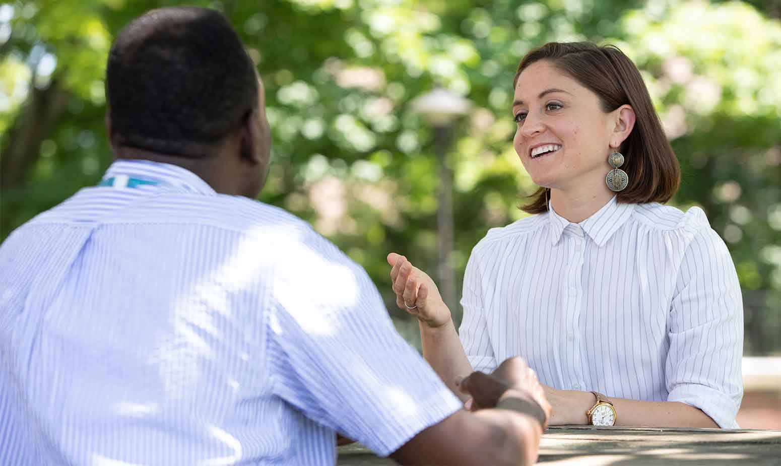 Young woman speaks with clinician