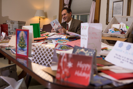 Dr. Rauch reads holiday cards for McLean patients