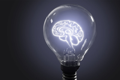 Brain image in light bulb