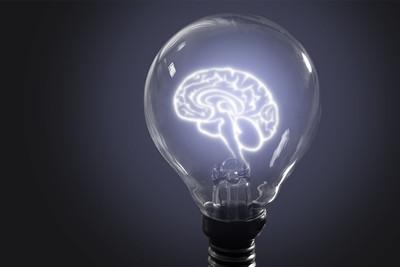 Brain image in light bulb
