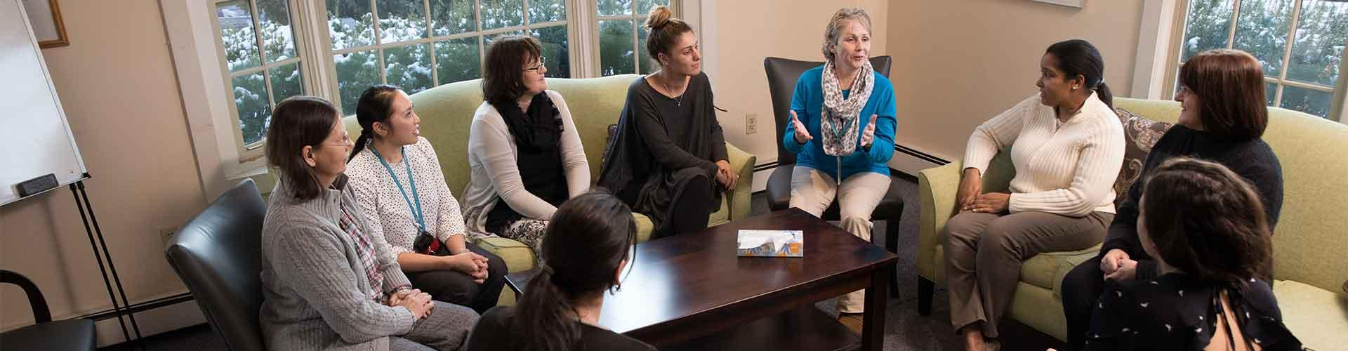 Women in group therapy in living room