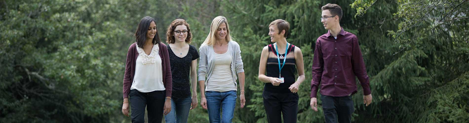 Patients and clinician walk outside