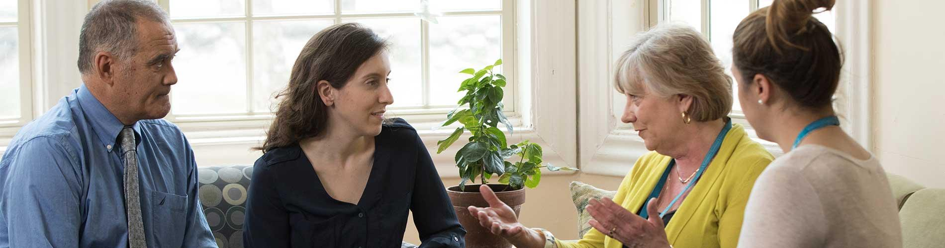 Clinicians discuss care with patient and father