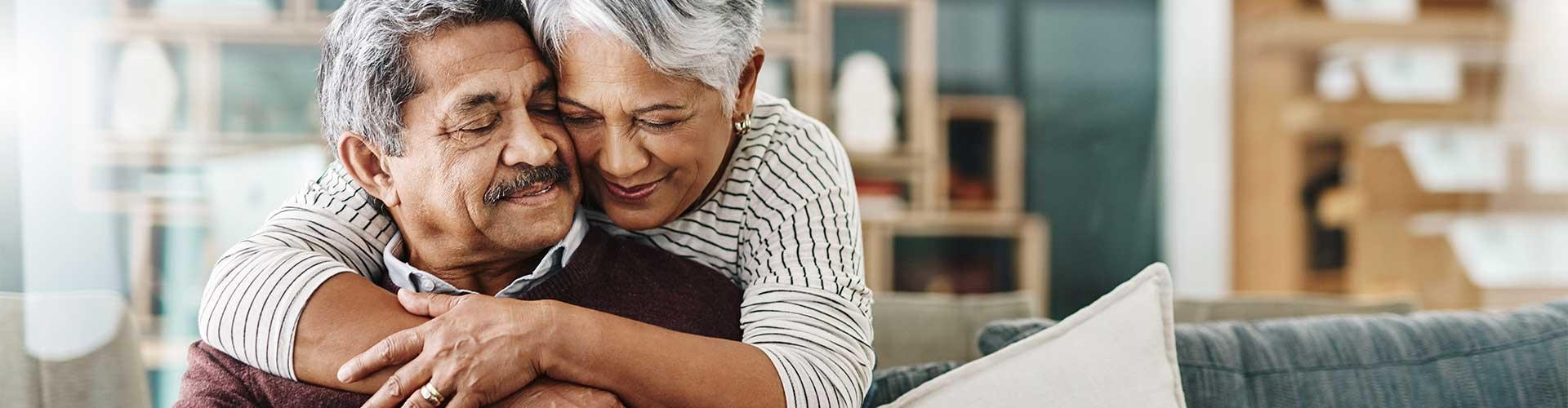 Stock photo of older man and woman embracing