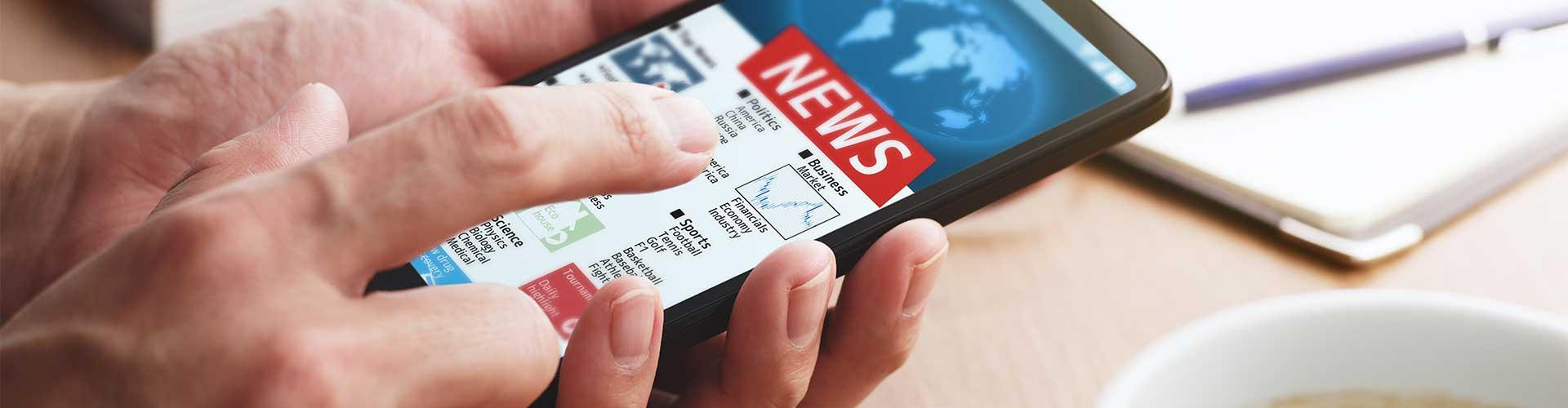 Stock photo of navigating news on smartphone