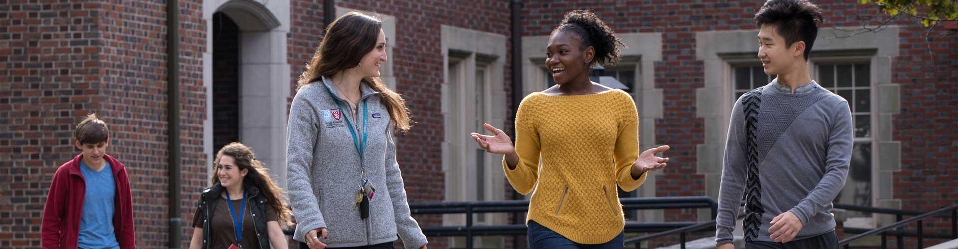 Teens walk outside with mental health clinicians