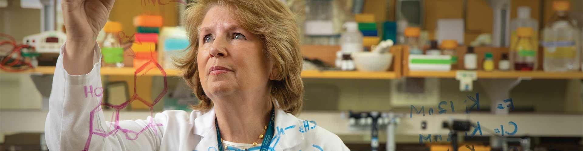 Dr. Bertha Madras works in a lab