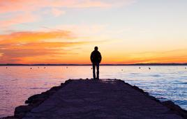 Stock image of man on jetty