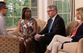 Clinicians speak with patient