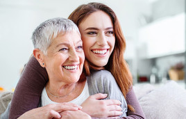 Young woman hugging older woman