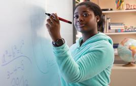 Arlington School student uses smartboard