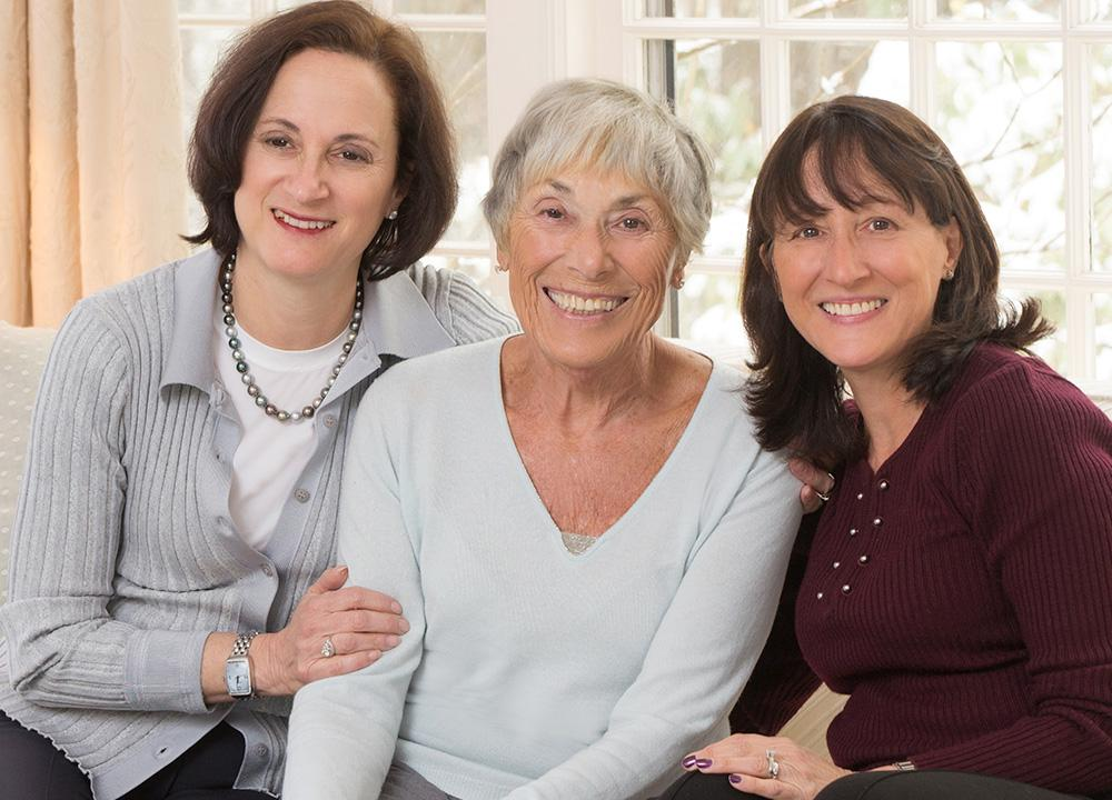Betty Brudnick surrounded by her two daughters