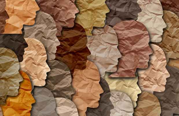 Graphic image of black and brown faces made out of paper